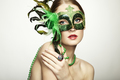 The beautiful young woman in a green mysterious venetian mask - PhotoDune Item for Sale