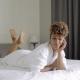 Lovely Model Lying on Bed in Bathrobe
