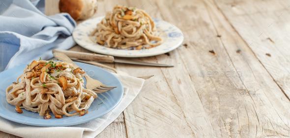 Whole wheat tagliolini with mushrooms Porcini - Stock Photo - Images