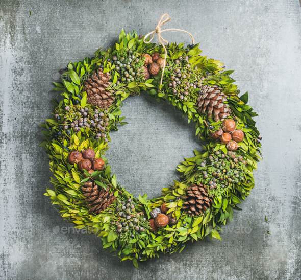 Christmas decorative wreath over concrete wall background - Stock Photo - Images
