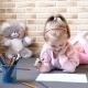Little Beautiful Girl Draws Sitting on the Floor and Plays with Toys - VideoHive Item for Sale