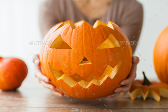 close up of woman with halloween pumpkin at home - Stock Photo - Images