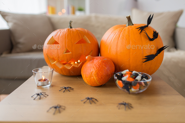 jack-o-lantern and halloween decorations at home - Stock Photo - Images