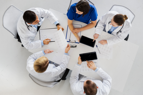 doctors with cardiograms and tablet pc at hospital - Stock Photo - Images