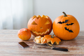 halloween jack-o-lantern, pumpkins and smartphone