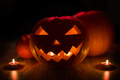 halloween jack-o-lantern burning in darkness