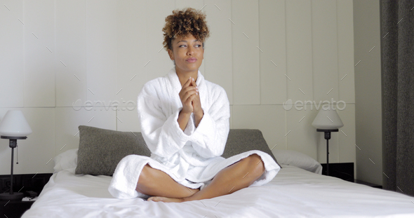 Charming girl posing on bed in hotel - Stock Photo - Images