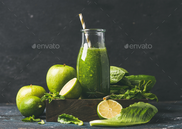 Green smoothie in glass bottle with apple, romaine lettuce, lime - Stock Photo - Images