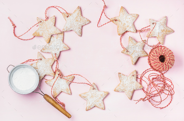 Christmas gingerbread star shaped cookies with sugar powder in sieve - Stock Photo - Images