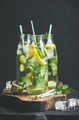 Citrus fruit and herbs infused sassi water in glass bottles