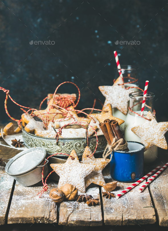 Christmas cookies, decoration rope, nuts, spices, milk, sugar powder - Stock Photo - Images