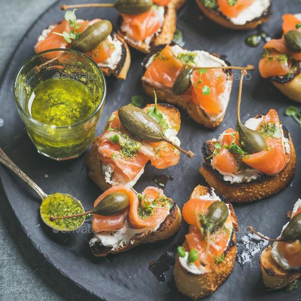 Close-up of salmon crostini with homemade pesto sauce - Stock Photo - Images