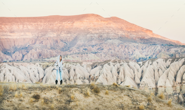 Young woman traveller hiking in mountains in Cappadocia, Central Turkey - Stock Photo - Images
