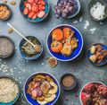 Ingredients for healthy breakfast in bowls over grey stone background - PhotoDune Item for Sale