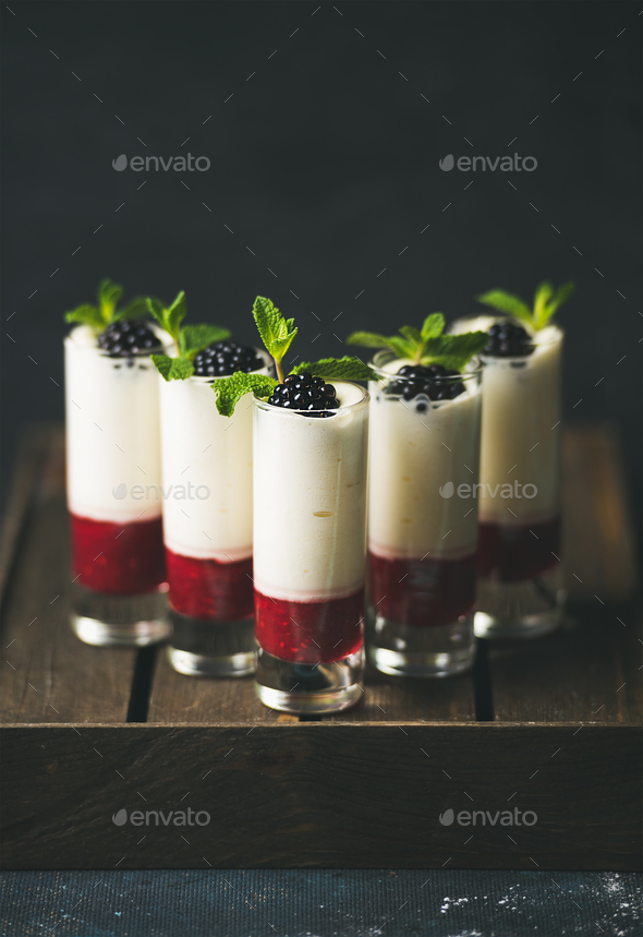 Homemade desserts with fresh blackberry and mint over dark background - Stock Photo - Images
