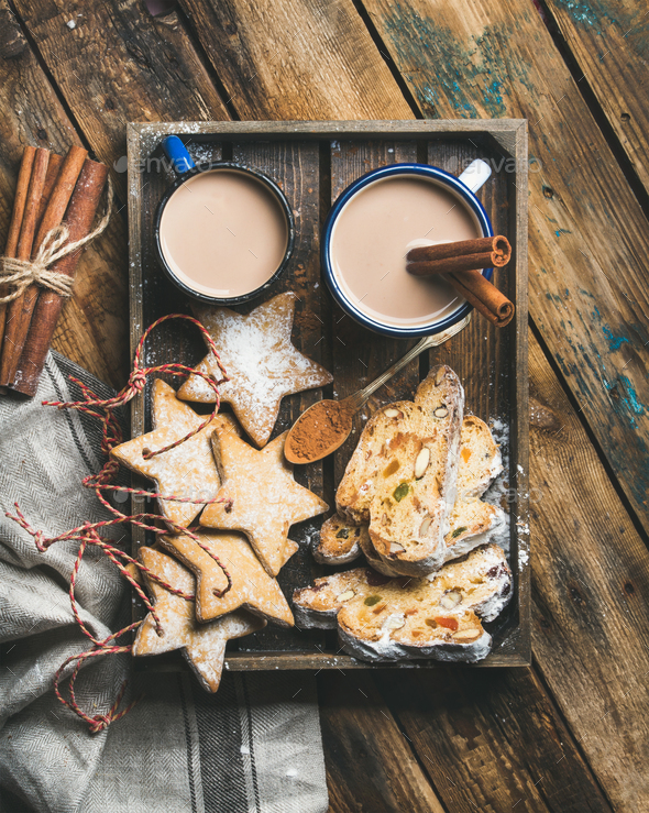 Cocoa in mugs with Christmas cookies, pieces of Stollen cake - Stock Photo - Images