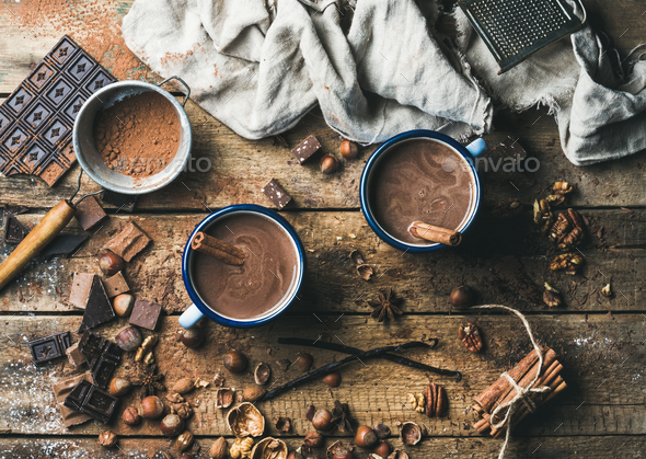 Hot chocolate with cinnamon sticks, anise, nuts and cocoa powder - Stock Photo - Images
