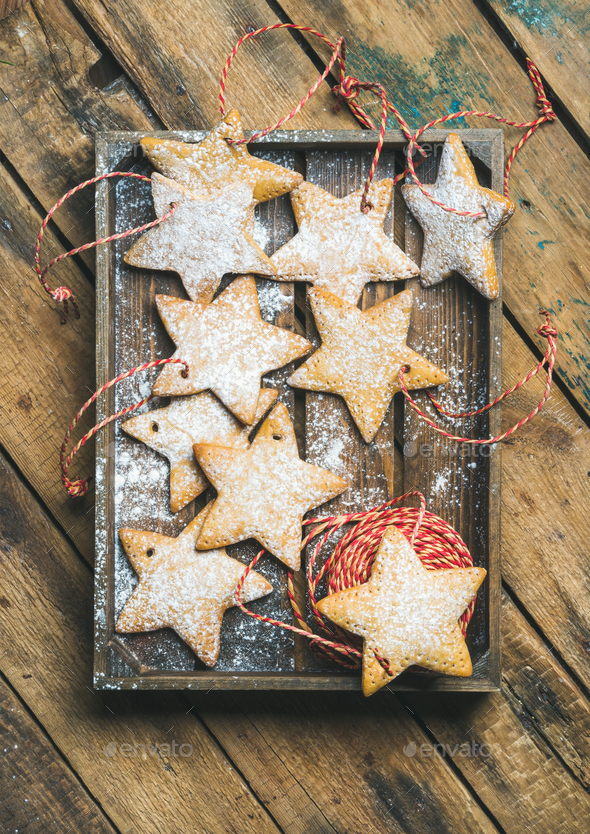 Christmas gingerbread cookies with sugar powder and decoration rope - Stock Photo - Images