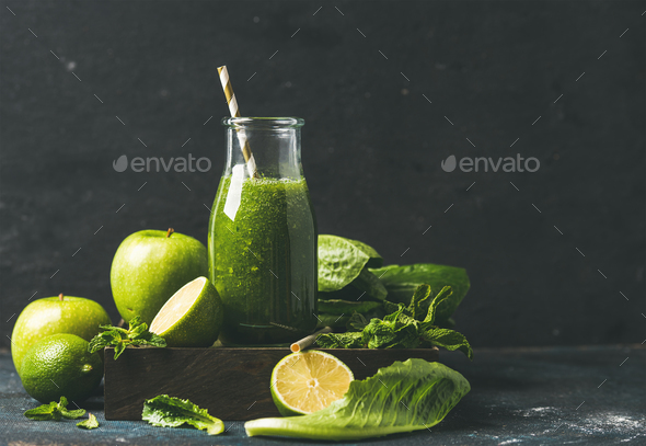 Smoothie with apple, romaine lettuce, lime, mint, dark blue background - Stock Photo - Images