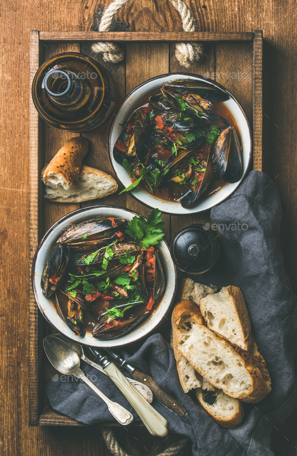 Flat-lay of Belgian boiled mussels in tomato sauce and beer - Stock Photo - Images