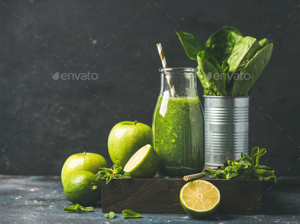 Green smoothie in bottle with fresh fruits, copy space - Stock Photo - Images