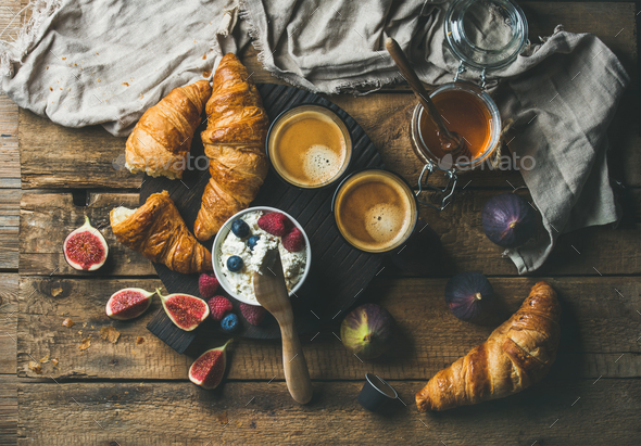 Breakfast with croissants, ricotta, figs, fresh berries, honey and espresso - Stock Photo - Images