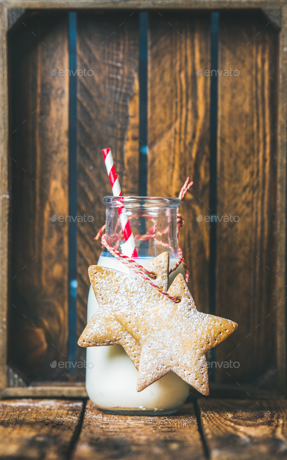 Bottle with milk and Christmas festive gingerbread star shaped cookies - Stock Photo - Images
