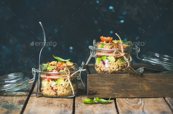 Homemade jar quinoa salad with cherry and sun-dried tomatoes, avocado - Stock Photo - Images