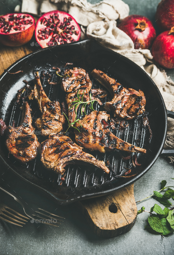 Grilled lamb meat chops served with fresh pomegranates and mint - Stock Photo - Images