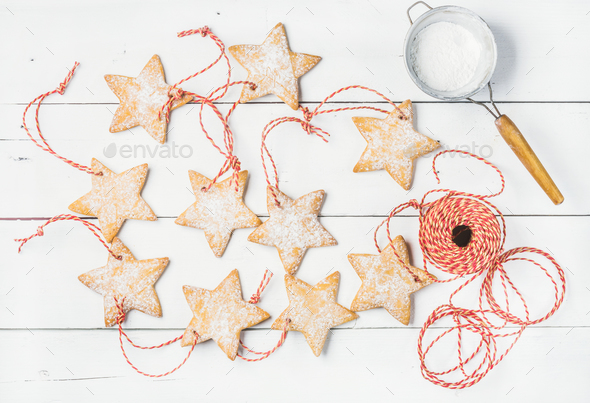 Christmas gingerbread homemade star shaped cookies with sugar powder - Stock Photo - Images