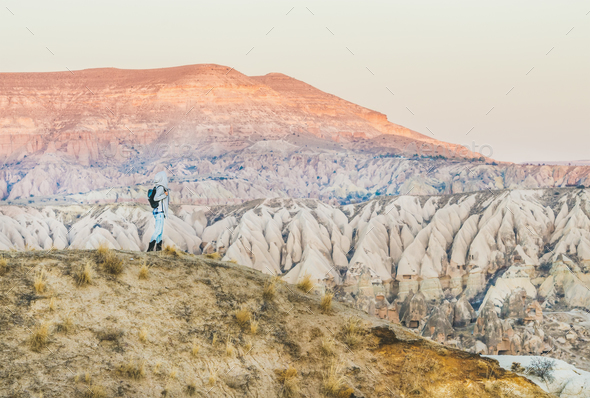 Young woman traveller hiking in mountains in Cappadocia, Turkey - Stock Photo - Images