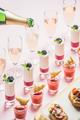 Various snacks, brushettas, gazpacho shots, desserts, champagne pouring to glasses