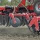 Sowing Machine Working on  Farming Field. Farming Tractor with Trailer Seeder - VideoHive Item for Sale