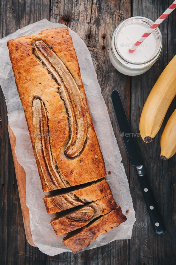 homemade banana bread on a wooden background - Stock Photo - Images