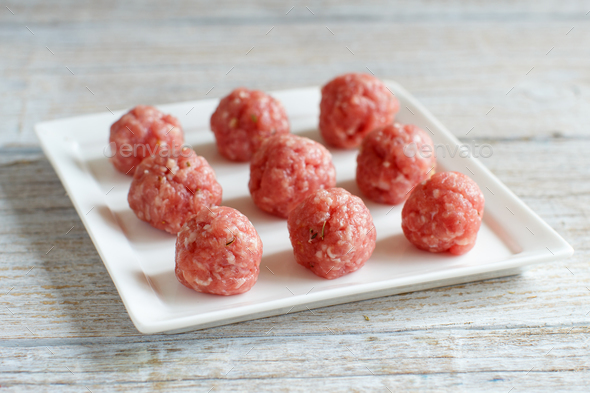 Raw  meatballs are ready to cook - Stock Photo - Images