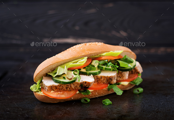 Big sandwich with chicken breasts, tomato, cucumber and herbs. - Stock Photo - Images