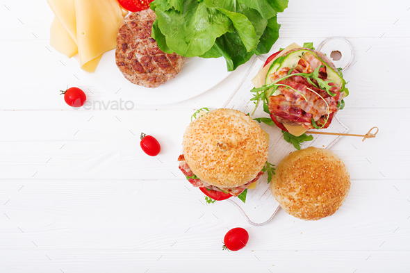 Big sandwich - hamburger burger with beef, cheese, tomato, cucumber  - Stock Photo - Images