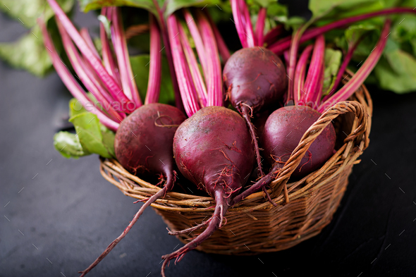 Young beetroot with a tops in a basket on a dark background. - Stock Photo - Images