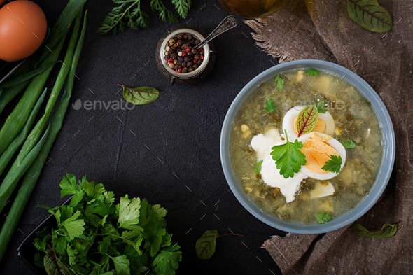 Green soup of sorrel in blue bowl. Flat lay. Top view - Stock Photo - Images
