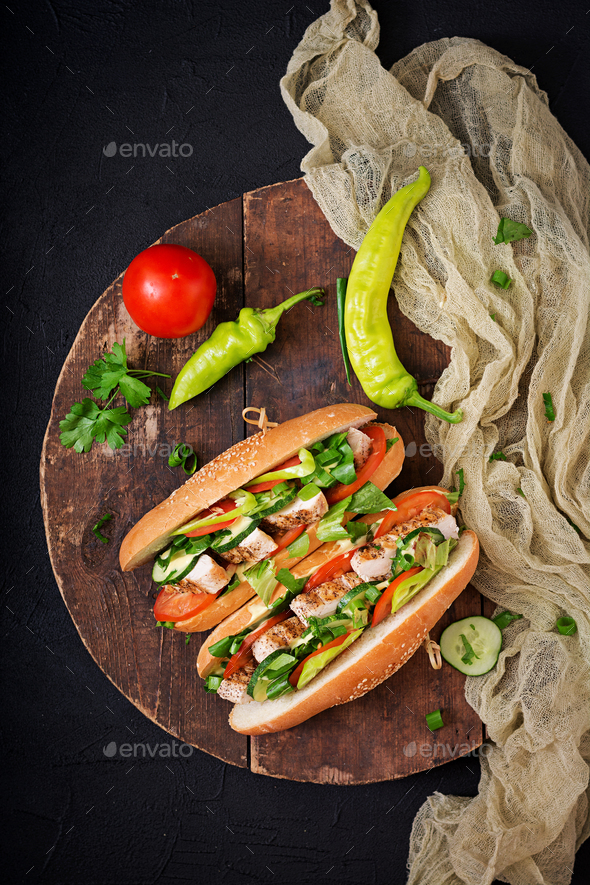 Big sandwich with chicken breasts, tomato, cucumber and herbs. Flat lay. Top view - Stock Photo - Images