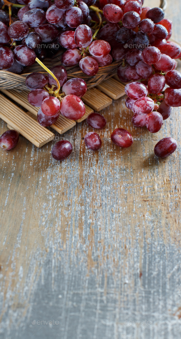 Grapes on a wooden table - Stock Photo - Images