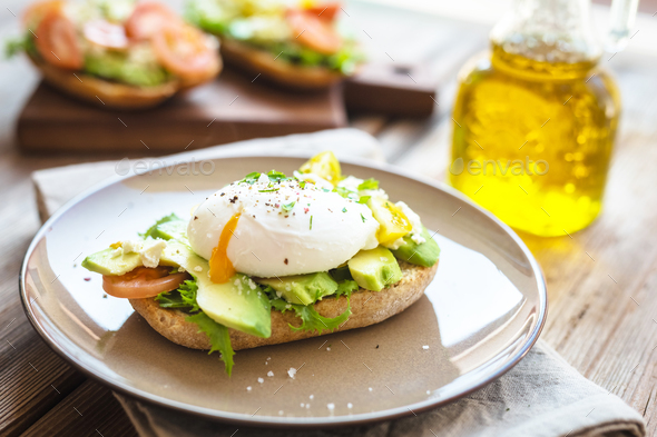Sandwich with avocado and poached egg - Stock Photo - Images