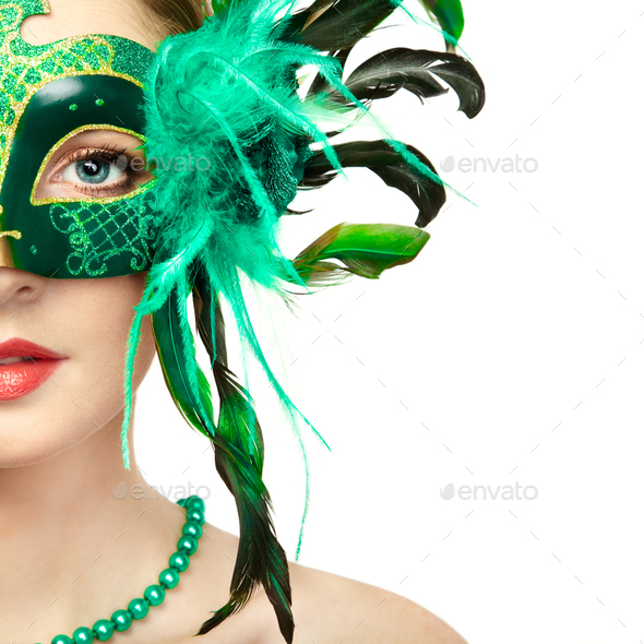 Beautiful young woman in mysterious green Venetian mask - Stock Photo - Images