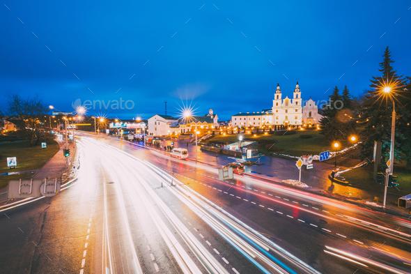 Minsk, Belarus. Night Traffic On Illuminated Street And  Cathedr - Stock Photo - Images