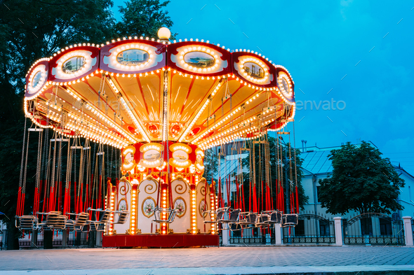 Brightly Illuminated Empty Carousel Merry-Go-Round. Nobody In Su - Stock Photo - Images