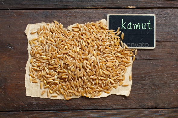 Pile of Kamut grain with a small chalkboard - Stock Photo - Images