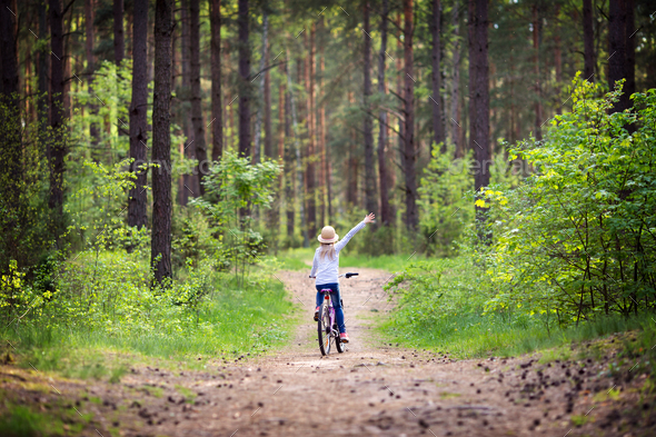Girl on the bike - Stock Photo - Images