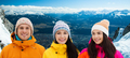 happy friends in winter over alps mountains