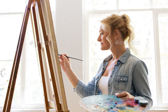 Woman Artist With Easel Painting At Art Studio