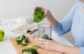 woman hand adding pea to measuring cup
